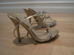 """My wedding shoes! Gold sandals-Aldo -  I had to get DIVA GELS to survive 10+ hours in these mofos. They're 4-5"""" high and despite wearing a wedding gown that touched the floor AND being inebriated I didn't fall down once on my big day."""